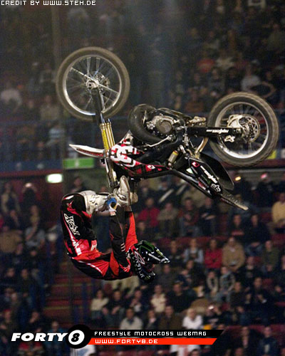 Adam Jones, top X Games Freestyle Motocross rider, throws his signature trick, the backflip cordova.